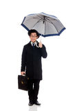 Young man holding suitcase and umbrella isolated Stock Images