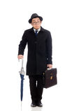 Young man holding suitcase and umbrella isolated Royalty Free Stock Photos