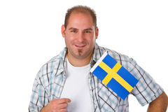 Young man holding swedish flag Stock Photos
