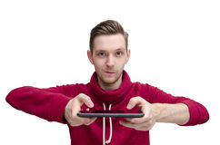 Young man holding tablet Royalty Free Stock Photos