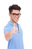 Young man holding thumbs up Stock Images