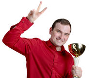 Young man holding a trophy Stock Image