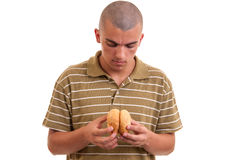 Young man holding two rolls with sesame and prepares to eat t Stock Image