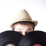 Young man holding two vinyl LP-s. Young man dj holding two vinyl LP-s Stock Photography