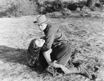 Young man holding an unconscious young woman. (All persons depicted are no longer living and no estate exists. Supplier grants that there will be no model Royalty Free Stock Photos