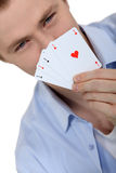 Young man holding up cards Stock Photos