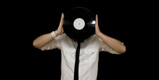 Young man holding vinyl record Stock Photo
