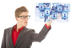Young man holding virtual friends isolated Stock Photography