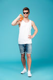 Young man holding water gun behind back Royalty Free Stock Photo