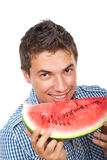 Young man holding water melon Royalty Free Stock Photos