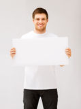 Young man holding white blank board Stock Photo