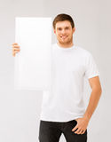 Young man holding white blank board Royalty Free Stock Image