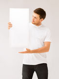 Young man holding white blank board Royalty Free Stock Photo