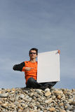 Young Man Holding White Card. At the beach stock photos