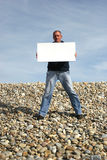 Young Man Holding White Card Royalty Free Stock Image