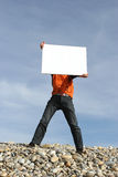 Young Man Holding White Card. At the beach stock photography