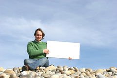 Young Man Holding White Card. At the beach royalty free stock photography