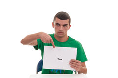 Young man holding white frame with TAX text and pointin Royalty Free Stock Photo