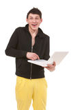 Young man holding white notebook Royalty Free Stock Image