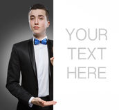 Young man holding a whiteboard Stock Photos