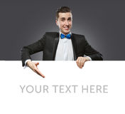 Young man holding a whiteboard royalty free stock image