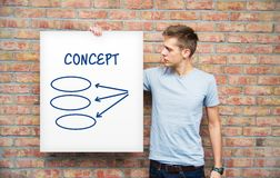 Young man holding whiteboard Royalty Free Stock Photo