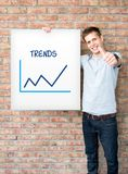 Young man holding whiteboard Royalty Free Stock Photography