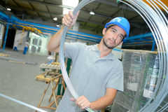 Young man holding wire roll. Young man holding a wire roll Stock Photos