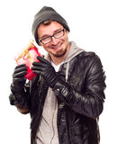 Young Man Holding Wrapped Gift To His Ear Royalty Free Stock Photos