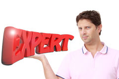 Young man holding the write `EXPERT` in red 3D letters Stock Photos