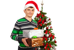 Young man holding Xmas gifts Stock Image