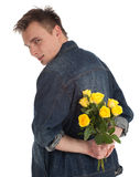 Young man holding a yellow roses Stock Photo
