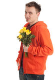 Young man holding a yellow roses Stock Photos