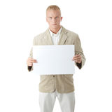 Young the man holds blank signs. Royalty Free Stock Photography