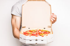 Young man holds boxes with pizza. Royalty Free Stock Image