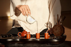 A young man holds a Chinese tea ceremony Stock Images