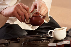 A young man holds a Chinese tea ceremony Royalty Free Stock Photography