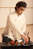 Young man holds a Chinese tea ceremony Stock Images