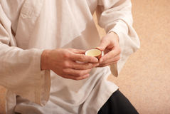 Young man holds a Chinese tea ceremony Royalty Free Stock Photo