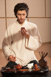 Young man holds a Chinese tea ceremony Stock Photo