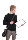 A young man holds a clipboard Stock Photography