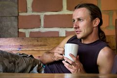 Young man holds a coffee cup Stock Image