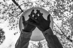 Free Young Man Holds His Crystal Bowl Solemnly In The Forest - From Under 1/2 Stock Images - 129888014