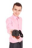 Young man holds in his hand black computer optical mouse Stock Images