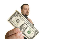 Young man holds in his hand  dollar Royalty Free Stock Images