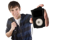 Young man holds out his mp3 player Stock Photography