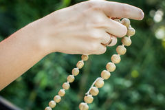 Young man holds a rosary in his hands and pray Royalty Free Stock Images