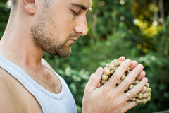 Young man holds a rosary in his hands and pray Royalty Free Stock Photography