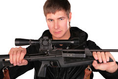 Young man holds sniper gun Royalty Free Stock Photo