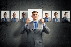 Young man holds up a photograph Stock Photos